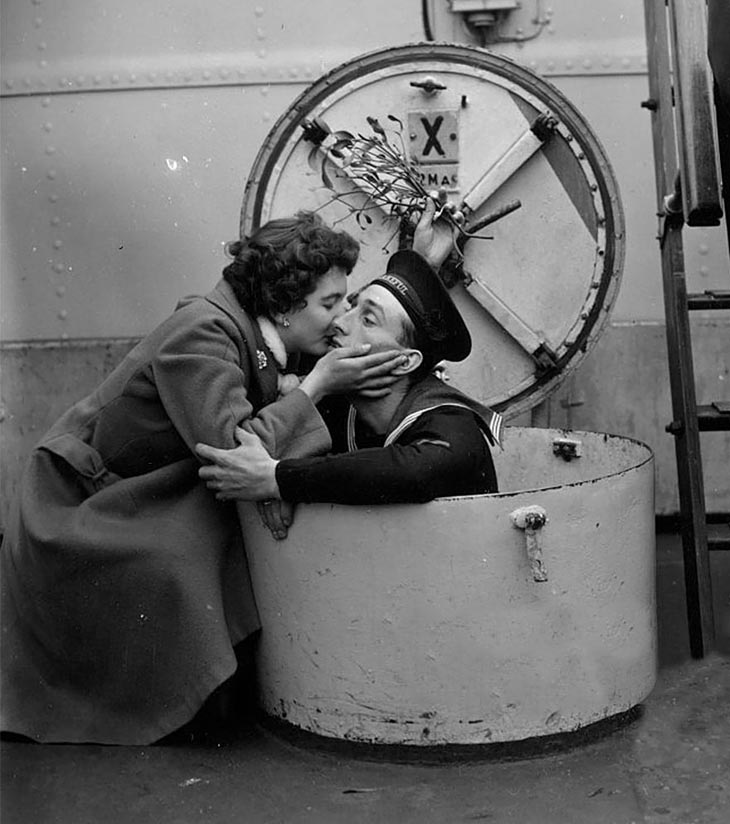 D. Brown Kissing Her Fiance Terry Under The Mistletoe, On Board The HMS Wakeful At Portsmout, 1955