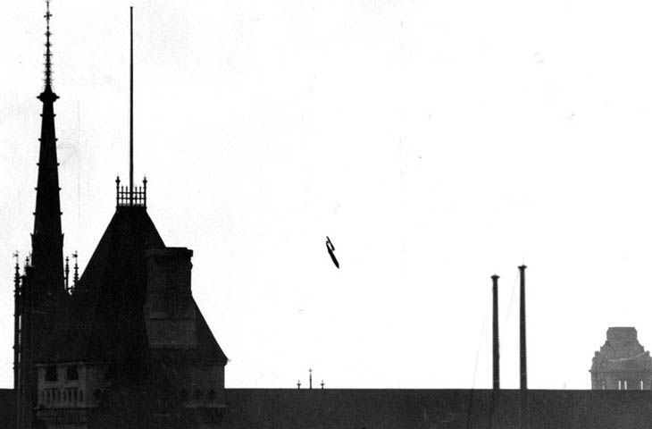 """A V-1 flying bomb """"buzzbomb"""" plunging toward central London, 1945"""